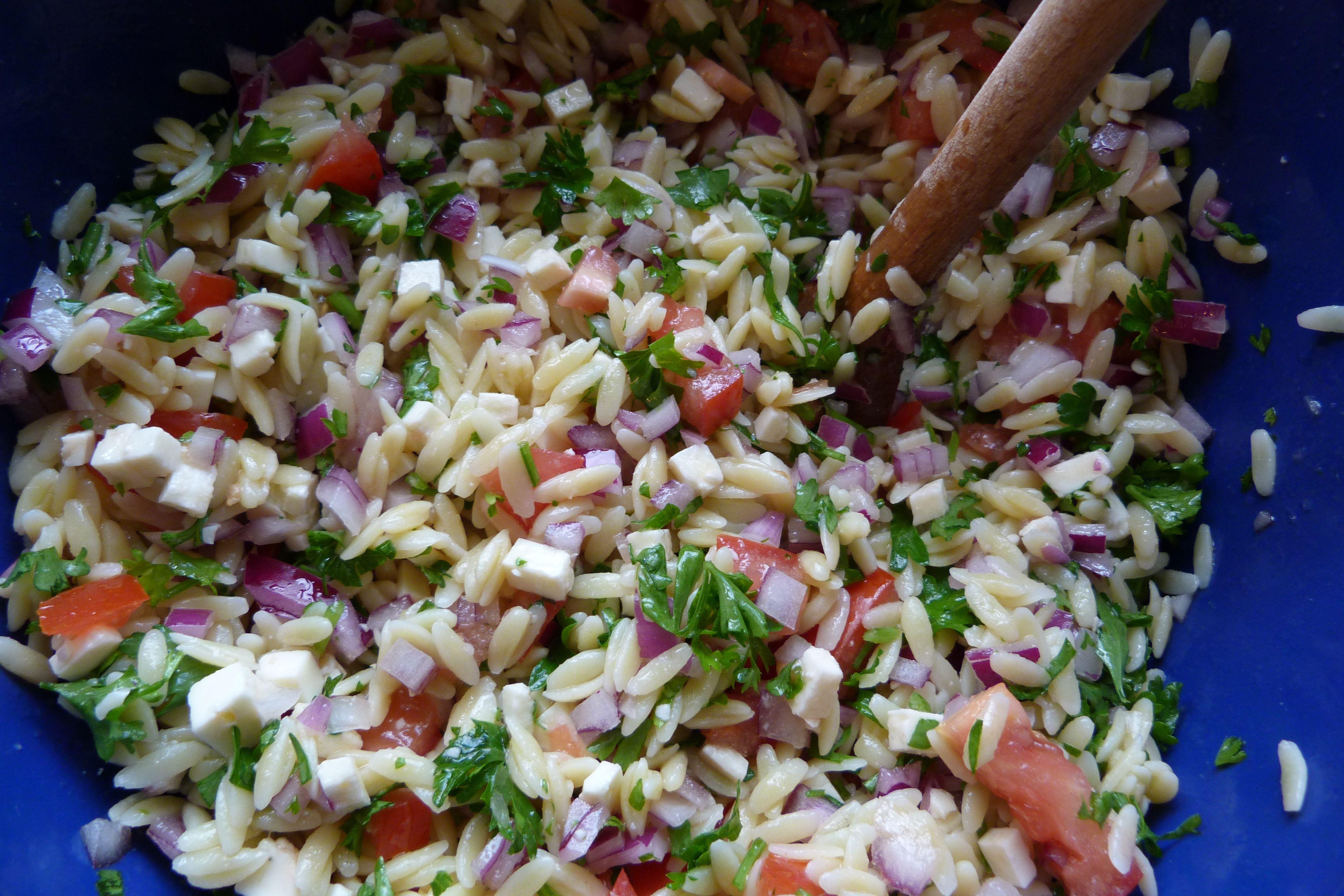 Mixing Orzo Salad